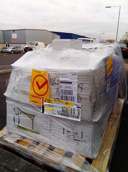 first shipment of ceramic olive oil bottles